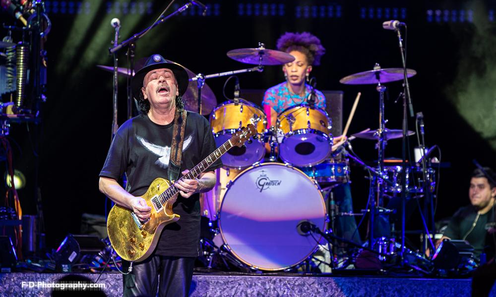 Woodstock '69 Vet Santana, With The Doobie Brothers In Tow